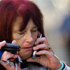 Globe/T. Rob Brown<br /> A crying woman who asked to not be identified makes a phone call outside Memorial Middle School Monday morning, Oct. 9, 2006, following a shooting at the school before students and parents were released from the building.<br /> Section: News