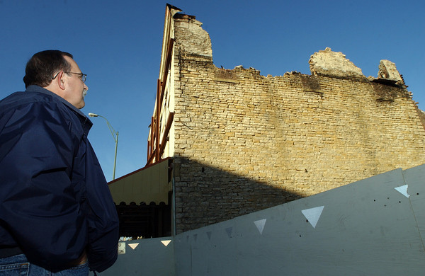 Globe/T. Rob Brown<br /> Fort Scott, Kan., Mayor Gary Billionis looks at city property which used to be a historic business building that burned, as seen Tuesday afternoon, Nov. 21, 2006, in downtown Fort Scott.<br /> Section: News Story: Wally K.