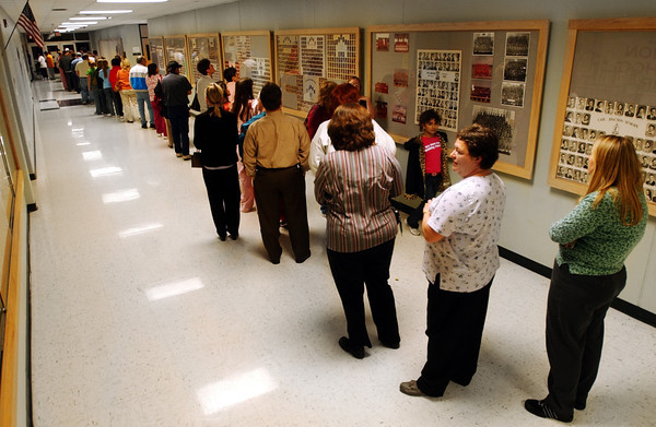 Globe/T. Rob Brown<br /> A long line to vote fills a long hallway outside the band room, which serves as a voting room, at Carl Junction High School Tuesday evening, Nov. 7, 2006.<br /> Section: News