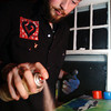 Globe/T. Rob Brown<br /> Christoph Jones of Joplin works on one of his spraypaint art pieces, this one has a mini-van theme, Tuesday evening, Dec. 12, 2006, at Jones' home.<br /> Section: ENJOY