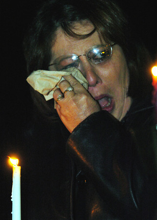 Globe/T. Rob Brown<br /> Becky Moyer of Quapaw, Okla., wipes at her tears as she holds a candle during a candlelight vigil outside the remains of the group home fire in Anderson Monday night, Dec. 4, 2006.<br /> Section: News