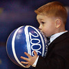 Globe/T. Rob Brown<br /> Caden Myers, son of Chris and Kerri Myers, brings out the McAuley High School Homecoming 2006 basketball, which almost seems to be as big as he is during the announcement of Queen Courtney Bobski, senior, daughter of Gary and Debbi Bobski, and escorted by senior Cole Moss, son of Dick and Margie Moss, prior to Friday night's Feb. 10, 2006, game against Purdy.<br /> Section: News