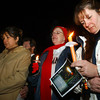 Globe/T. Rob Brown<br /> Niki Holbrook of Noel (right) lowers her head in a moment of silence as she and Shelly Smith of Anderson (center) and Bertha Contreras (left) hold candles during a candlelight vigil outside the remains of the group home fire in Anderson Monday night, Dec. 4, 2006.<br /> Section: News