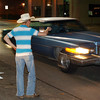 Globe/T. Rob Brown<br /> Kevin Thompson, 17, of Neosho, tries to get the attention of a driver on Main Street Joplin Friday night, Oct. 27, 2006. He and several friends like to hang out downtown, visit with friends and make new friends.<br /> Section: News
