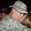 Globe/T. Rob Brown<br /> Mike Abram of Carl Junction, a member of the 414th Military Police Company, kisses his wife, Jodi Abram, upon arriving back in Joplin, from Iraq, at the U.S. Army Reserve Center.<br /> Section: News