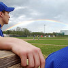 Globe/T. Rob Brown<br /> McAuley Catholic High School's Jonathan Lewis, left, and teammate Jon Carr, right, look out over the field at Joe Becker Stadium to see a rainbow as they played College Heights Christian School Tuesday evening, March 27, 2007, in Joplin, Mo.