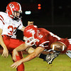 Globe/T. Rob Brown<br /> Carl Junction's Zack Porath (15) stops the punt from Aurora's  Lucas Ackley (39) during Friday night's game, Oct. 5, 2007, at Carl Junction, Mo.