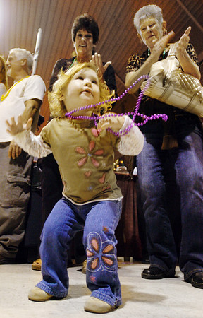 The Joplin Globe/T. Rob Brown<br /> Ellah Crawford, 1, of Joplin, Mo., dances to the music of The Ben Miller Band of Joplin during The Taste of the Four States event at the Holiday Inn Convention Center in Joplin, Tuesday night, Oct. 21, 2008.
