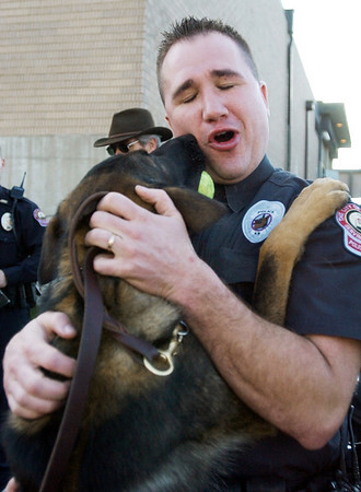The Joplin Globe/T. Rob Brown<br /> Gunner, Joplin, Mo., Police Officer Gabe Allen's K-9 partner, jumps up into his partner's arms for a hug during a demonstration at the Donald Clark Justice Center in Joplin Monday afternoon, Feb. 4, 2008.