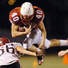The Joplin Globe/T. Rob Brown<br /> Webb City (Mo.) High School's Braxton Baker leaps up and over Branson (Mo.) High School defender Mike Jaris during Wednesday night's game, Nov. 5, 2008, at Webb City.