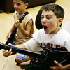 Globe/T. Rob Brown<br /> Nathan McCauley, 10, really gets into a game of Guitar Hero with co-member Dalton Jones, 9, at the Joplin Boys & Girls Club Wednesday afternoon, Aug. 5, 2009.