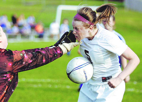 Globe/T. Rob Brown<br /> Joplin's Ashlea Norman attempts to control the ball as Hillcrest goaltender collides with her Thursday evening, April 22, 2010, at Joplin's field. No foul was called.