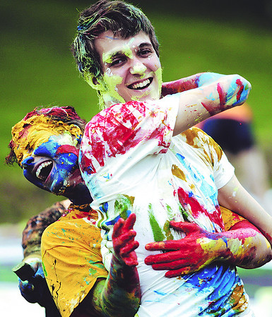 Globe/T. Rob Brown<br /> Neosho High School seniors Jeremy Ponski (right) and Tara Newcomb attempt to add another coat of paint to each other on Senior Hill Tuesday morning, May 11, 2010, outside the high school.