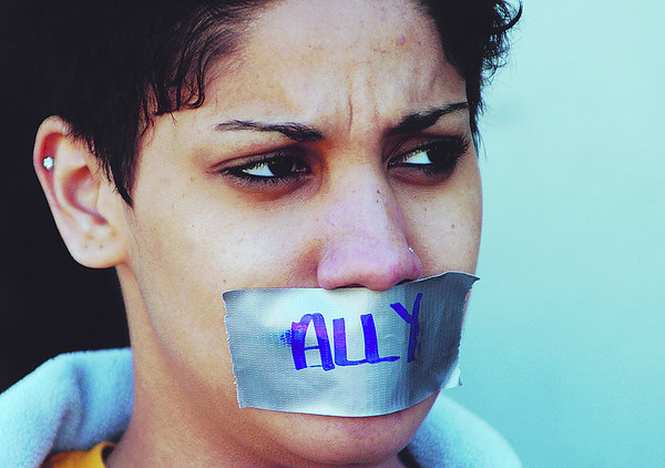 "Globe/T. Rob Brown<br /> Shani Ciarrochi, Missouri Southern freshman psychology and theater major, wears duct tape that reads ""Ally"" as part of a protest by a group of students against an MSSU policy that does not protect from discrimination based on sexual orientation. Students carried signs that read, ""Update the non-descrimination policy"" and ""We can't shut our mouths about descrimination on campus."""