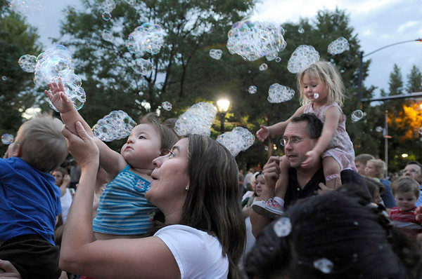 "Liliana Wellington, 37, of Longmont, at left, and her daughter Joslyn, 1, try to catch some bubbles at the 2010 Festival on Main on Friday, Aug. 27, in Longmont.<br /> Jeremy Papasso/ Camera<br /> <br /> For photo gallery and video go to  <a href=""http://www.dailycamera.com"">http://www.dailycamera.com</a>"