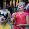 Grayson Gonyon, 3, and his sister Charlotte, both of Windsor, look up at a giant puppet at the 2010 Festival on Main on Friday, Aug. 27, in Longmont.<br /> Jeremy Papasso/ Camera