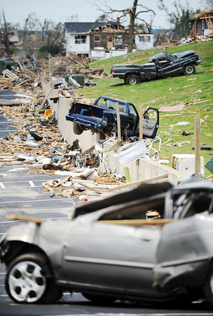 Globe/T. Rob Brown<br /> A row of tornado-thrown vehicles lay Tuesday afternoon, May 31, 2011, behind a damaged business just off the intersection of 26th and McCoy in Joplin, Mo.