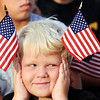Globe/T. Rob Brown<br /> Conrad Proctor, 7 and a Joplin second grader, holds U.S. flags on his head as educators enter MSSU's Taylor Performing Arts Center Monday morning, Aug. 15, 2011, prior to a new school year kickoff. Joplin classes begin Wednesday.