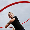 """Globe/T. Rob Brown<br /> Timothy Whitaker, 10, of Joplin, competes in a hula-hoop competition Wednesday evening, Aug. 10, 2011, during """"I Am Joplin"""" outside Missouri Southern State University's Fred G. Hughes Stadium."""