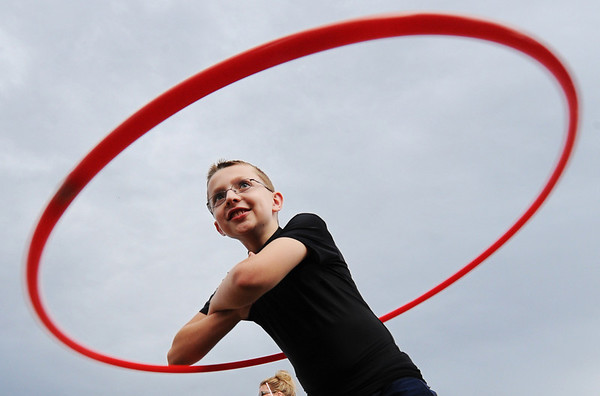 "Globe/T. Rob Brown<br /> Timothy Whitaker, 10, of Joplin, competes in a hula-hoop competition Wednesday evening, Aug. 10, 2011, during ""I Am Joplin"" outside Missouri Southern State University's Fred G. Hughes Stadium."
