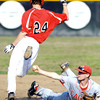 Globe/T. Rob Brown<br /> Carl Junction runner Payton Walker attempts to dodge a tag attempt by Nixa infielder Andrew Stepp Thursday afternoon, May 5, 2011, at Carl Junction's field. Walker was called out on the play.