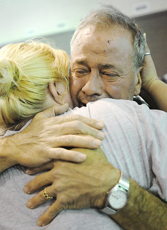 Globe/T. Rob Brown<br /> Bob Harbottle, who lost his Joplin home, gets a hug from fellow church member Wendy Chapman, of Diamond, during a community prayer service Wednesday evening, May 25, 2011, for all affected by Sunday's tornado, at the Joplin Family Worship Center on East 7th Street.