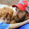 Globe/T. Rob Brown<br /> Four-year-old Griffan Keller clutches onto a Teddy bear and his father, Travis Keller, while listening to Joplin City Manager Mark Rohr during a Q & A Friday evening, May 27, 2011, outside the American Red Cross shelter at Missouri Southern State University's Leggett & Platt Athletic Center. The Kellers lost their home, formerly located at 2601 S. Virginia Ave., during Sunday's tornado.