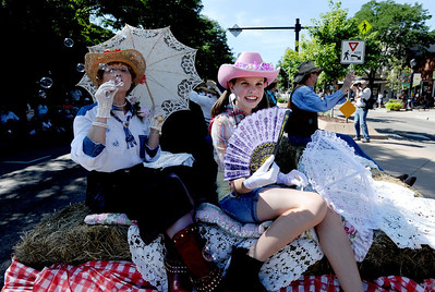 Jeanie Miller and granddaughter, Shaye, of the Historical Hover Home, blow bubbles during the parade down Main Street in Longmont on Saturday. For more photos and a video of the parade, go to www.dailycamera.com. Cliff Grassmick / July 28, 2011