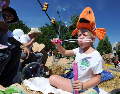 Julianne Herman is prepared with bubbles on a float in the Boulder County Fair Parade on Saturday. For more photos and a video of the parade, go to www.dailycamera.com. Cliff Grassmick / July 28, 2011