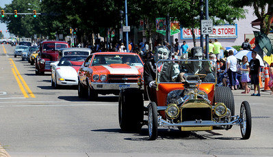 """Grandpa"" and ""Herman Munster"" drive their vintage car,  followed by the ColoRODans Car Club,  during the Boulder County Fair Parade down Main Street in Longmont on Saturday. For more photos and a video of the parade, go to www.dailycamera.com. Cliff Grassmick / July 28, 2011"