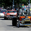 """Grandpa"" and ""Herman Munster"" drive their vintage car,  followed by the ColoRODans Car Club,  during the Boulder County Fair Parade down Main Street in Longmont on Saturday.<br /> For more photos and a video of the parade, go to  <a href=""http://www.dailycamera.com"">http://www.dailycamera.com</a>.<br /> Cliff Grassmick / July 28, 2011"