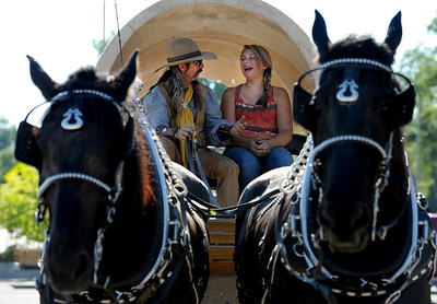 George LaRoe, left, and Shauna White, of Kiowa Creek Coaches, prepare to join the Boulder County Fair Parade on Saturday in Longmont. For more photos and a video of the parade, go to www.dailycamera.com. Cliff Grassmick / July 28, 2011