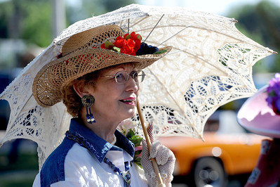 Jeanie Miller of the Historical Hover Home ladies, protects herself from the sun on Saturday. For more photos and a video of the parade, go to www.dailycamera.com. Cliff Grassmick / July 28, 2011