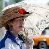 "Jeanie Miller of the Historical Hover Home ladies, protects herself from the sun on Saturday.<br /> For more photos and a video of the parade, go to  <a href=""http://www.dailycamera.com"">http://www.dailycamera.com</a>.<br /> Cliff Grassmick / July 28, 2011"