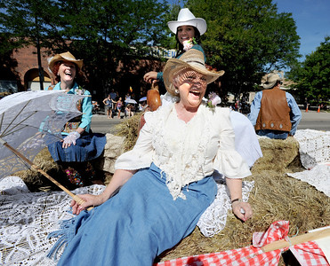 Luella Lindqiust, joins the other ladies of the Historical Hover Home with a leisurely ride down Main Street during the Boulder County Fair Parade. For more photos and a video of the parade, go to www.dailycamera.com. Cliff Grassmick / July 28, 2011