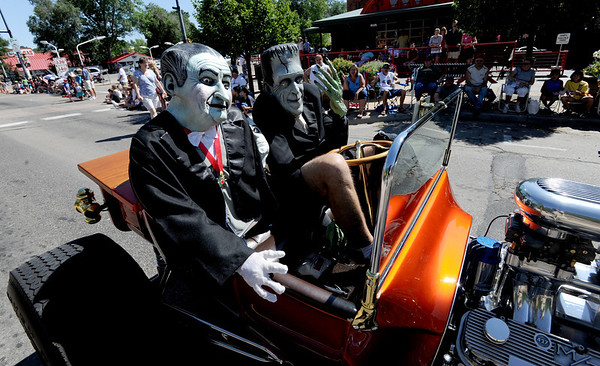 """Grandpa"" and ""Herman Munster"" drive their vintage car during the parade down Main Street in Longmont on Saturday.<br /> For more photos and a video of the parade, go to  <a href=""http://www.dailycamera.com"">http://www.dailycamera.com</a>.<br /> Cliff Grassmick / July 28, 2011"