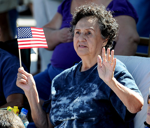 "Mickey Martinez waves at the floats and bands in the Boulder County Fair Parade on Saturday.<br /> For more photos and a video of the parade, go to  <a href=""http://www.dailycamera.com"">http://www.dailycamera.com</a>.<br /> Cliff Grassmick / July 28, 2011"