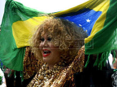 A transvestite participates at the 16th. Gay Pride Parade in Copacabana beach, Rio de Janeiro, Brazil, October 9, 2011. (Austral Foto/Renzo Gostoli)
