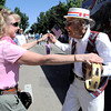 Hugh McGinty (left) dances with Jan Hansen (left) during the Louisville Labor Day Parade in Louisville, Colorado September 5, 2011.   CAMERA/Mark Leffingwell