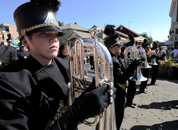 Monarch High School band member Calvin Holmberg stands ready while waiting for their performance in front of the judges during the Louisville Labor Day Parade in Louisville, Colorado September 5, 2011.   CAMERA/Mark Leffingwell