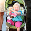 Arizona Keeney, 15 months, plays with an American flag while watcing the start of the Louisville Labor Day Parade in Louisville, Colorado September 5, 2011.   CAMERA/Mark Leffingwell