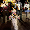 "Miles Hoskins, 1, runs down the street dressed as a lion with the rest of his family dressed as characters from the Wizard of Oz, pictured left to right, Jason Hoskins, 34, Corie Hoskins, 32, Norm Poppe, 56, and Carole Poppe, 56, all of Morrison, during the Mall Crawl on Saturday, Oct. 29, on Pearl Street in Boulder. For more photos and a video of the Mall Crawl go to  <a href=""http://www.dailycamera.com"">http://www.dailycamera.com</a><br /> Jeremy Papasso/ Camera"