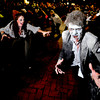"Dave Coleman, 24, of Boulder, right, plays the part of a zombie while participating in the Michael Jackson ""Thriller"" flash mob on Saturday, Oct. 29, during the Mall Crawl on Pearl Street in Boulder. For more photos and a video of the Mall Crawl go to  <a href=""http://www.dailycamera.com"">http://www.dailycamera.com</a><br /> Jeremy Papasso/ Camera"
