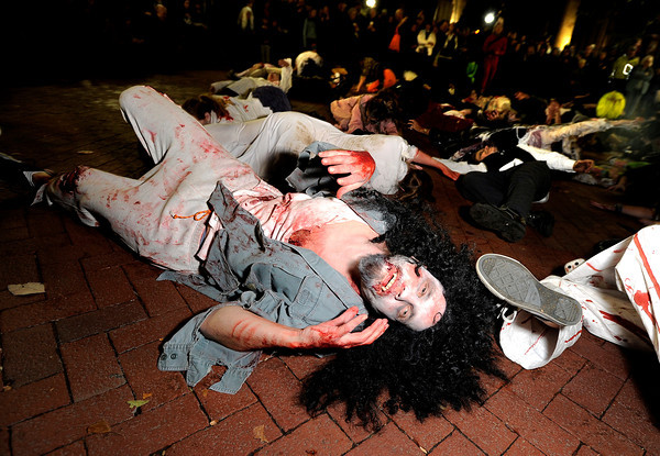 "Ben Alexandra, 40, of Boulder, wakes up from a zombie sleep while participating in the Michael Jackson ""Thriller"" flash mob on Saturday, Oct. 29, during the Mall Crawl on Pearl Street in Boulder. For more photos and a video of the Mall Crawl go to  <a href=""http://www.dailycamera.com"">http://www.dailycamera.com</a><br /> Jeremy Papasso/ Camera"