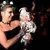 "Danica Powell, 38, of Boulder, holds her daughter Lina, 1, while dressed in costume during a Michael Jackson ""Thriller"" flash mob on Saturday, Oct. 29, during the Mall Crawl on Pearl Street in Boulder. For more photos and a video of the Mall Crawl go to  <a href=""http://www.dailycamera.com"">http://www.dailycamera.com</a><br /> Jeremy Papasso/ Camera"