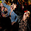 "Tracy Shulsinger, 30, of Boulder, right, yells like a zombie while participating in the Michael Jackson ""Thriller"" flash mob on Saturday, Oct. 29, during the Mall Crawl on Pearl Street in Boulder. For more photos and a video of the Mall Crawl go to  <a href=""http://www.dailycamera.com"">http://www.dailycamera.com</a><br /> Jeremy Papasso/ Camera"