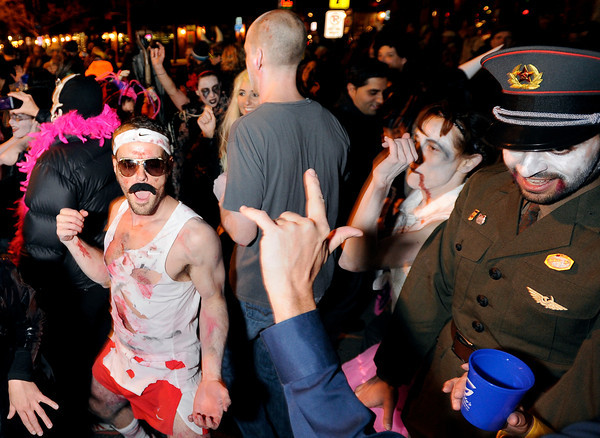 "Mike Procopio, 32, of Boulder, left, dances in the street with the rest of the crowd on Saturday, Oct. 29, during the Mall Crawl on Pearl Street in Boulder. For more photos and a video of the Mall Crawl go to  <a href=""http://www.dailycamera.com"">http://www.dailycamera.com</a><br /> Jeremy Papasso/ Camera"