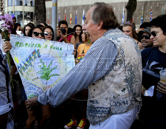 Brazilian deputy and former Environment minister Carlos Minc, right, participates at the Liberty March for free expression for feminists, gays and marijuana consumers in Copacabana, Rio de Janeiro, Brazil, June 18, 2011. The Brazilian Supreme Court approved past June 15, 2011, that demonstrations favoring the legalization of marijuana are an exercise of free expression and do not encourage people to consume marijuana.(Austral Foto/Renzo Gostoli)