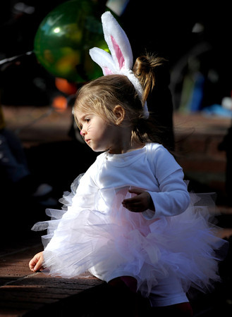 Adelyn Mehok sits down to look at the other kids during the Munchkin Masquerade on the Pearl Street Mall in Boulder, Colorado October 31, 2011.  CAMERA/Mark Leffingwell