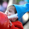 Taos Leary, 11 months, plays with a balloon during the Munchkin Masquerade on the Pearl Street Mall in Boulder, Colorado October 31, 2011.  CAMERA/Mark Leffingwell